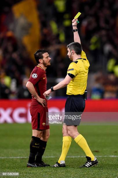 Alessandro Florenzi of Roma gets a yellow card during the UEFA Champions League Round of 16 match between Roma and Shakhtar Donetsk at Stadio...
