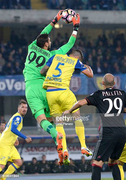 Alessandro Gamberini of AC Chievo Verona compete with Gianluigi Donnaruma goalkeeper of AC Milan during the Serie A match between AC ChievoVerona and...