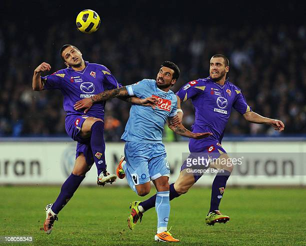 Alessandro Gamberini of Fiorentina and Ezequiel Lavezzi of Napoli and Loreno De Silvestri of Fiorentina in action during the Serie A match between...