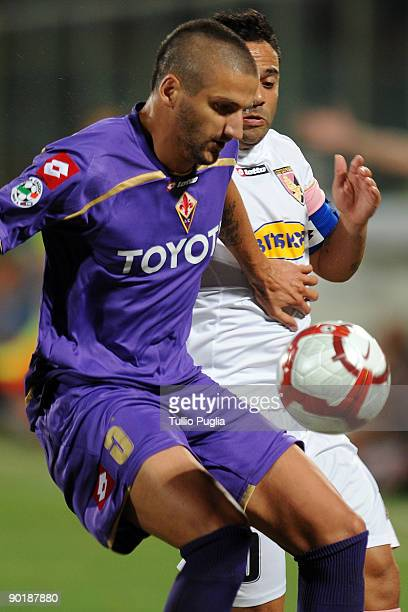 Alessandro Gamberini of Fiorentina and Fabrizio Miccoli of Palermo battle for the ball during the Serie A match between ACF Fiorentina and US Citta...