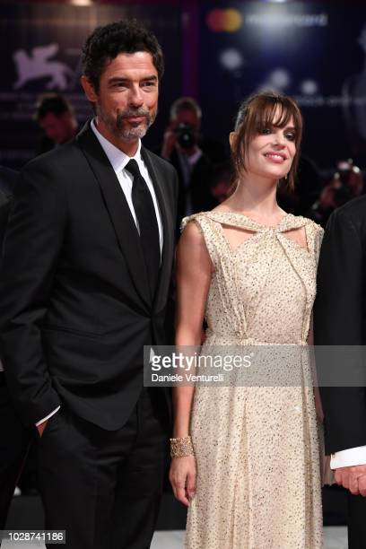 Alessandro Gassmann and Micaela Ramazzotti walk the red carpet ahead of the 'Una Storia Senza Nome' screening during the 75th Venice Film Festival at...
