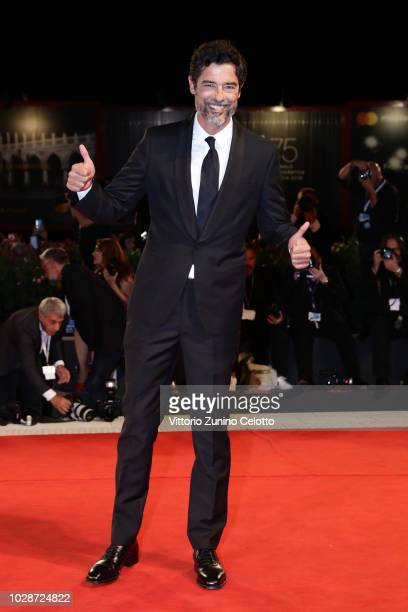 Alessandro Gassmann walks the red carpet ahead of the Una Storia Senza Nome screening during the 75th Venice Film Festival at Sala Grande on...