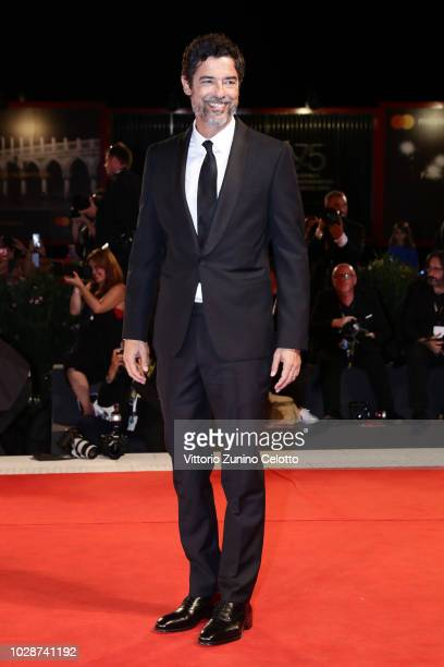 Alessandro Gassmann walks the red carpet ahead of the 'Una Storia Senza Nome' screening during the 75th Venice Film Festival at Sala Grande on...