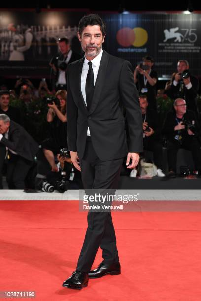 Alessandro Gassmann walks the red carpet ahead of the'Una Storia Senza Nome' screening during the 75th Venice Film Festival at Sala Grande on...