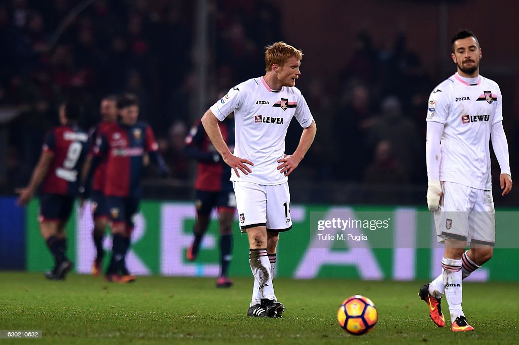 Alessandro Gazzi (C) and Ilija Nestorovski of Palermo show their dejection after Genoa's second goal during the Serie A match between Genoa CFC and US Citta di Palermo at Stadio Luigi Ferraris on December 18, 2016 in Genoa, Italy.