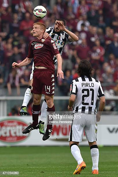 Alessandro Gazzi of Torino FC goes up with Leonardo Bonucci of Juventus FC during the Serie A match between Torino FC and Juventus FC at Stadio...