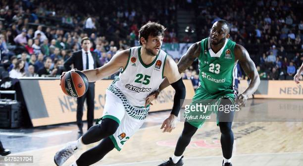 Alessandro Gentile #25 of Panathinaikos Superfoods Athens competes with James Anderson #23 of Darussafaka Dogus Istanbul during the 2016/2017 Turkish...