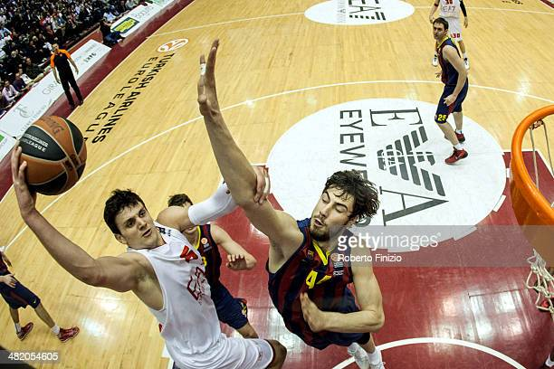 Alessandro Gentile, #5 of EA7 Emporio Armani Milan competes with Ante Tomic, #44 of FC Barcelona during the 2013-2014 Turkish Airlines Euroleague Top...