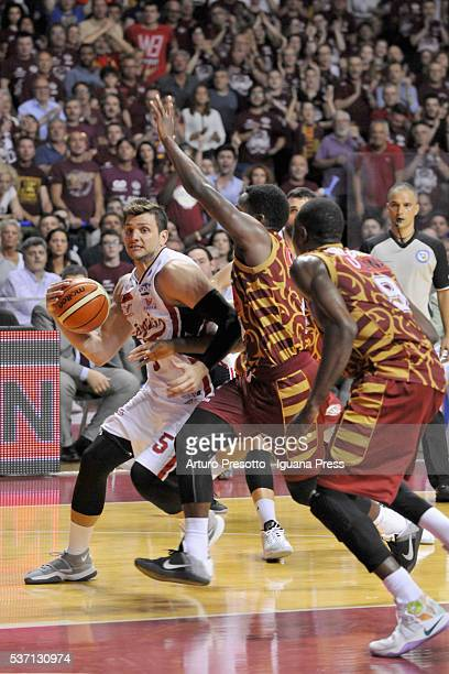Alessandro Gentile of EA7 competes with Mike Green and Ousman Krubally of Umana during the LegaBsaket Serie A match between Reyer Umana Venezia and...
