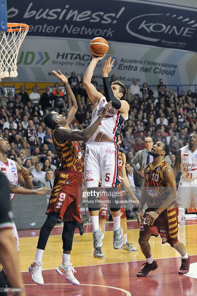 Alessandro Gentile of EA7 competes with Ousman Krubally (L) and Mike Green (R) of Umana during the LegaBsaket Serie A match between Reyer Umana Venezia and EA7 Emporio Armani Olimpia Milano at Palasport Taliercio on May 29, 2016 in Mestre, Italy.