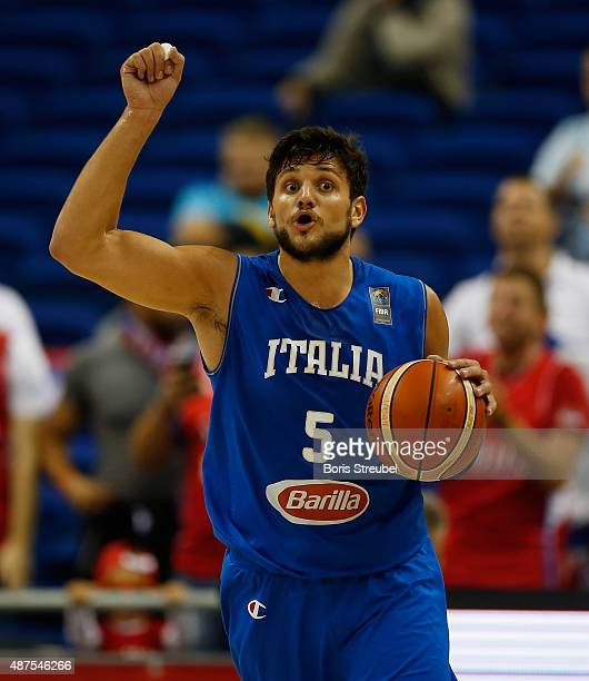 Alessandro Gentile of Italy dribbles the ball during the FIBA EuroBasket 2015 Group B basketball match between Serbia and Italy at Arena of...