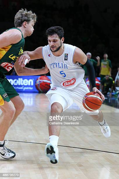 Alessandro Gentile of Italy drives to the basket against Mindaugas Kuzminskas of Lithuania during the EuroBasket Quarter Final game between Italy v...