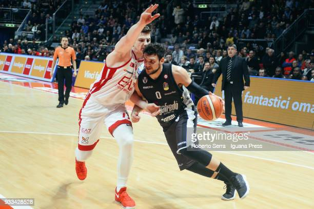 Alessandro Gentile of Segafredo competes with Arturas Gudaitis of EA7 during the LBA LegaBasket of Serie A match between Virtus Segafredo Bologna and...