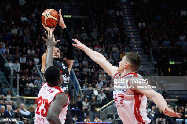 Alessandro Gentile of Segafredo competes with Awadu Abass Abass and Arturas Gudaitis of EA7 during the LBA LegaBasket of Serie A match between Virtus...