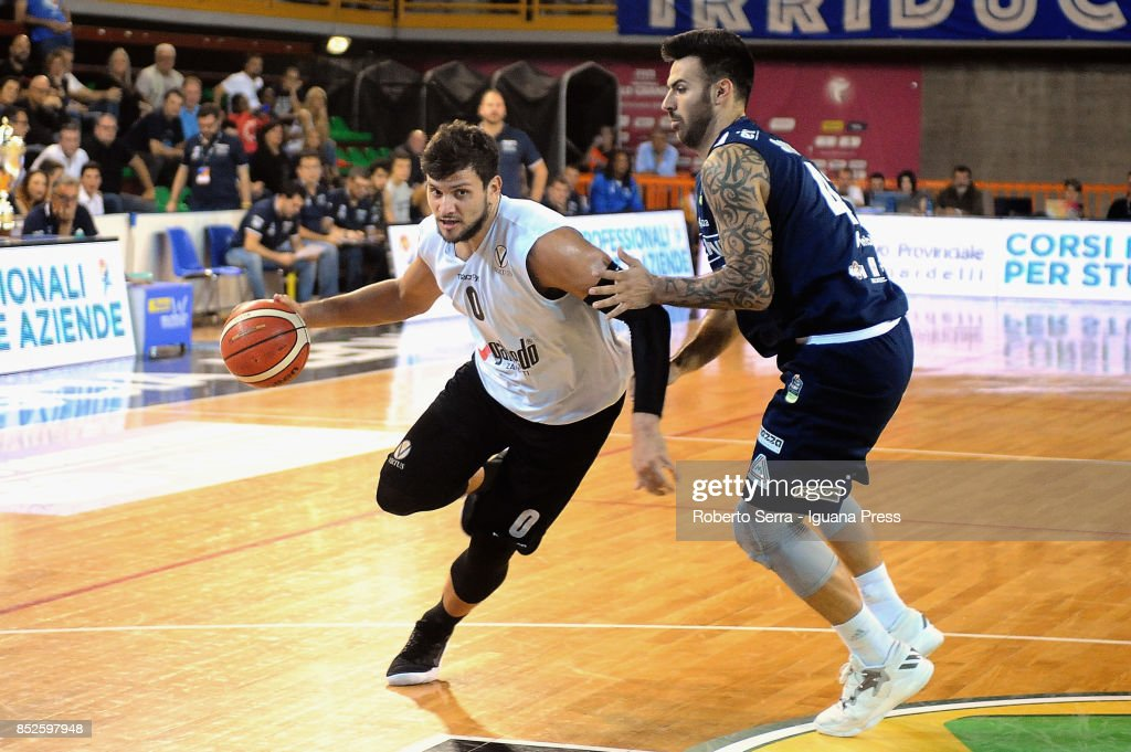 Alessandro Gentile of Segafredo competes with Brian Sacchetti of Germani during the match between Virtus Segafredo Bologna and Leonessa Germani Brescia of the Roberto Ferrari Basketball Trophy at PalaGeorge on September 23, 2017 in Montichiari, Italy.