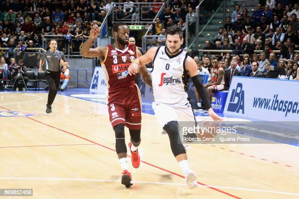 Alessandro Gentile of Segafredo competes with Dominique Johnson of Umana during the LBA LegaBasket of Serie A match between Virtus Segafredo Bologna...