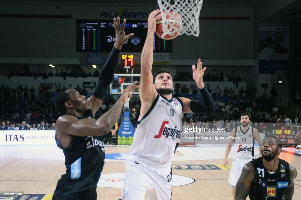 Alessandro Gentile of Segafredo competes with Dominique Sutton (L) and Chane Behanan (R) of Dolomiti Energia during the LBA LegaBasket match between Virtus Segafredo Bologna and Aquila Dolomiti Energia Trento at PalaTrento on September 30, 2017 in Trento, Italy.
