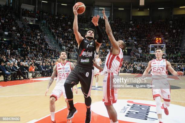 Alessandro Gentile of Segafredo competes with Vladimir Micov and Andrew Goudelock and Kaleb Tarczewski of EA7 during the LBA LegaBasket of Serie A...