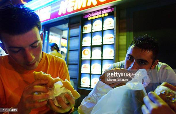 Alessandro Ghibellini and Claudio Ratti Italian students from the Primo Levi Technical Institute of Vignola in the Modena Province eat hamburgers at...