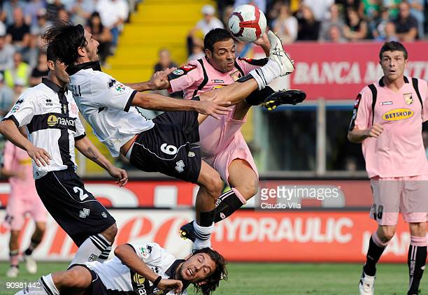Alessandro Lucarelli of Parma and Fabrizio Miccoli of Palermo battle for the ball during the Serie A match between Parma F.C. And Palermo U.S. At...