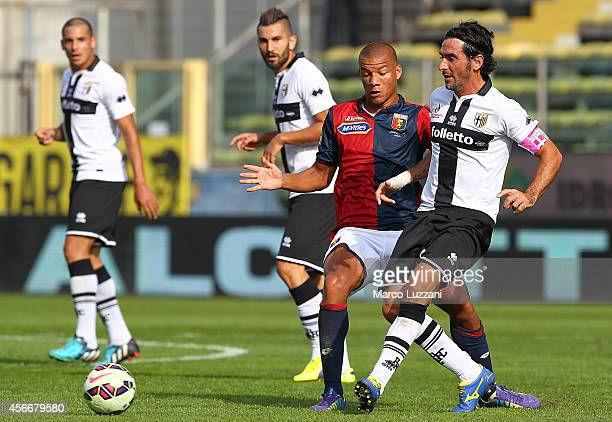 Alessandro Lucarelli of Parma FC is challenged by Sebastian De Maio of Genoa CFC during the Serie A match between Parma FC and Genoa CFC at Stadio...