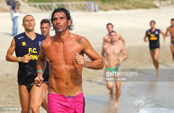 Alessandro Lucarelli of Parma FC runs on the beach during a Parma FC preseason training session at Rosa Marina Resort on July 8 2013 in Ostuni Italy