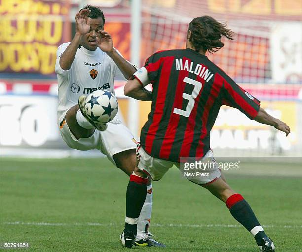 Alessandro Mancini of Roma clashes with Paolo Maldini of Milan during the Serie A match between Milan and Roma played at the San Siro stadium on May...