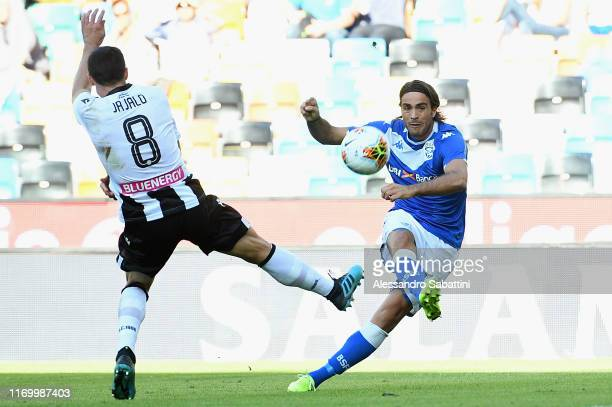 Alessandro Matri of Brescia Calcio competes for the ball with Mato Jajalo of Udinese Calcio during the Serie A match between Udinese Calcio and...