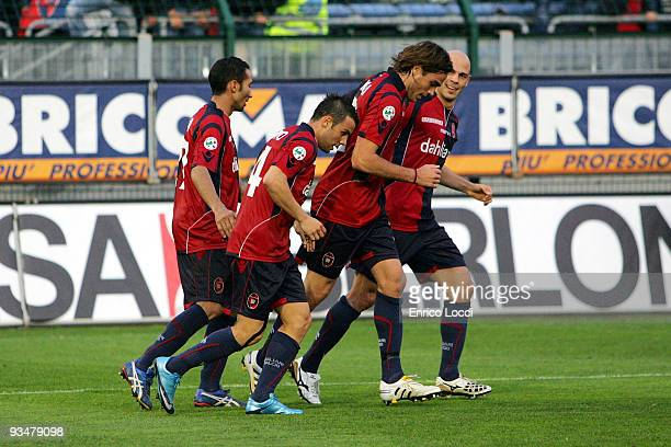 Alessandro Matri of Cagliari celebrates his 2:0 goal with teammates during the Serie A match between Cagliari and Juventus at Stadio Sant'Elia on...