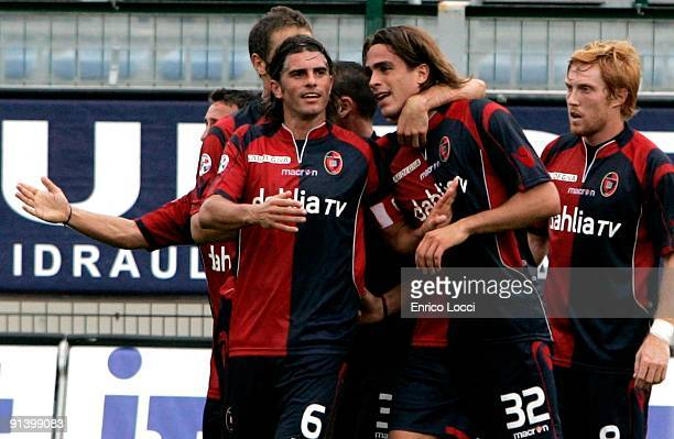 Alessandro Matri of Cagliari is congratulated after scoring a goal during the Serie A match between Cagliari and Chievo Verona at Stadio Sant'Elia on...