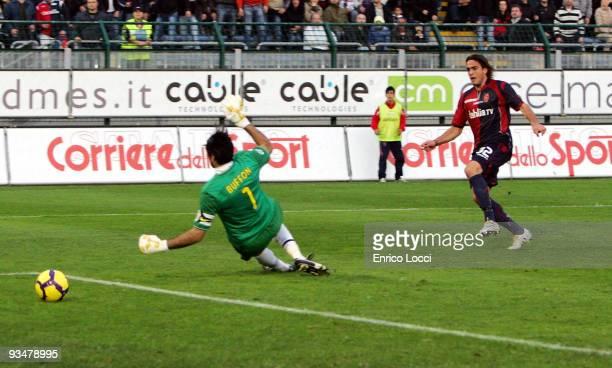 Alessandro Matri of Cagliari scores the 20 goal past Juventus goalkeeper Gianluigi Buffon during the Serie A match between Cagliari Calcio and...