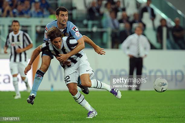 Alessandro Matri of FC Juventus is challenged by Mike Edwards of Notts County during the pre season friendly match between FC Juventus and Notts...