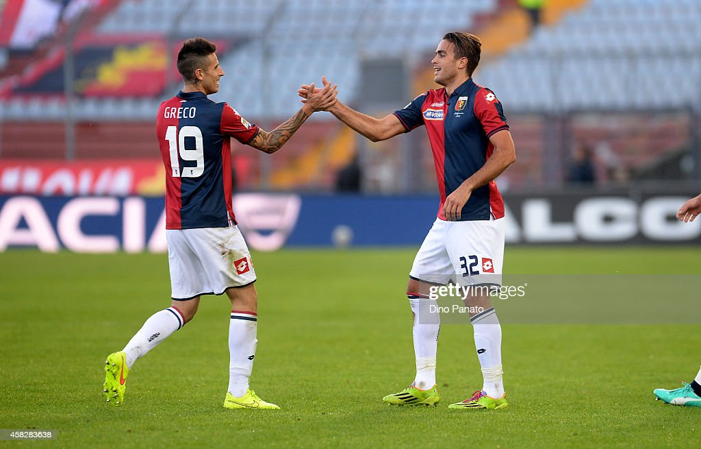 Alessandro Matri (R) of Genoa CFC celebrates after scoring his team's third goal during the Serie A match between Udinese Calcio and Genoa CFC at Stadio Friuli on November 2, 2014 in Udine, Italy.