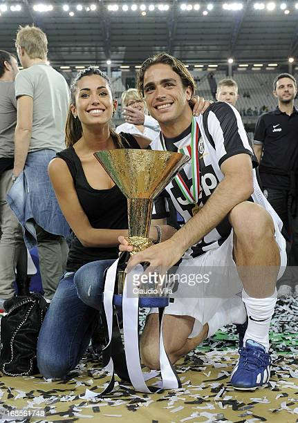 Alessandro Matri of Juventus FC and Federica Nargi celebrate with the Serie A trophy after the Serie A match between Juventus and Cagliari Calcio at...