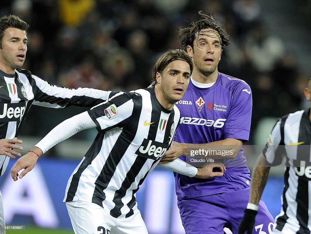 Alessandro Matri of Juventus FC and Luca Toni of ACF Fiorentina (R) during the Serie A match between Juventus FC and ACF Fiorentina at Juventus Arena on February 9, 2013 in Turin, Italy.