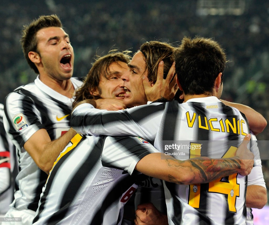 Alessandro Matri (C) of Juventus FC celebrates scoring the first goal during the Serie A match between Juventus FC and Genoa CFC on October 22, 2011 in Turin, Italy.