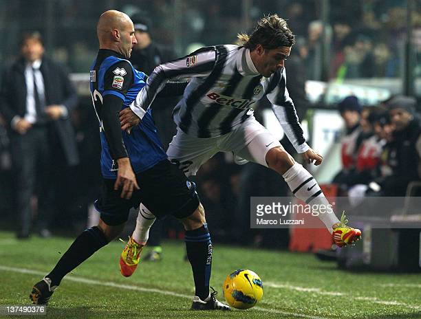 Alessandro Matri of Juventus FC competes for the ball with Michele Ferri of Atalanta BC during the Serie A match between Atalanta BC and Juventus FC...