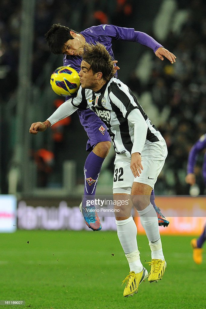 Alessandro Matri (R) of Juventus FC goes up with Stefan Savic of ACF Fiorentina during the Serie A match between Juventus FC and ACF Fiorentina at Juventus Arena on February 9, 2013 in Turin, Italy.