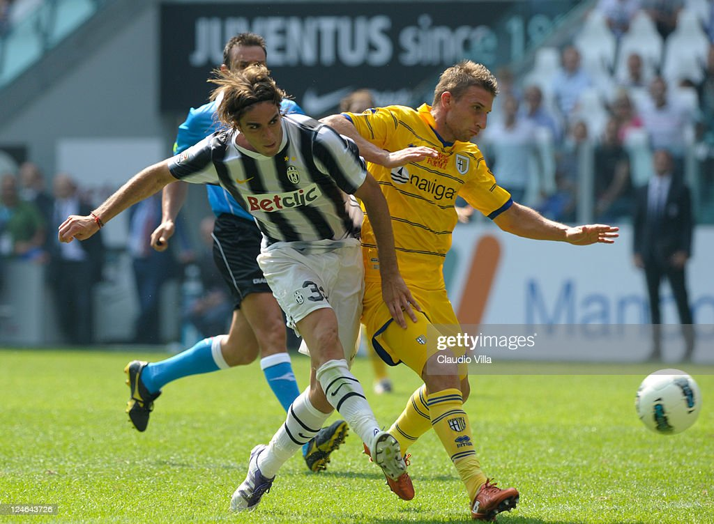Alessandro Matri of Juventus FC (L) in action against Matteo Rubin of Parma FC during the Serie A match between Juventus FC v Parma FC at Juventus Stadium on September 11, 2011 in Turin, Italy.