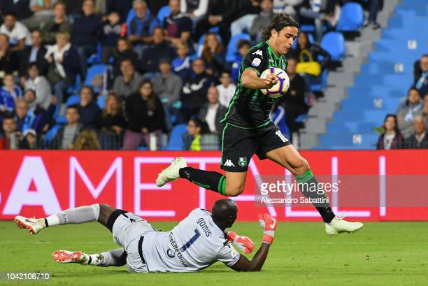 Alessandro Matri of Sassuolo competes for the ball with Alfred Gomis of Spal during the serie A match between SPAL and US Sassuolo at Stadio Paolo...
