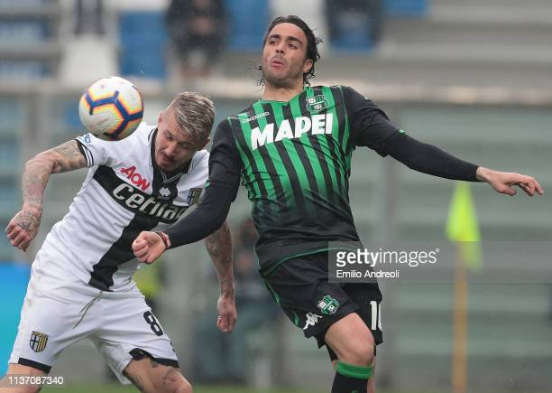 Alessandro Matri of US Sassuolo competes for the ball with Juraj Kucka of Parma Calcio during the Serie A match between US Sassuolo and Parma Calcio...