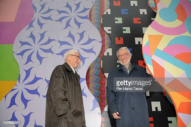 Alessandro Mendini and Francesco Mendini pose in front of their installation Surface at Interni Legacy press preview at Milan Design week on April 16...