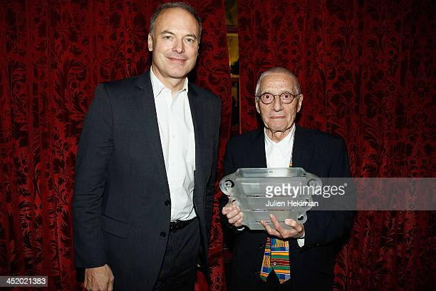 Alessandro Mendini poses with Renaud Dutreil after being awarded Special Price of the Jury during the 12th Convention for Luxury And Creation at...