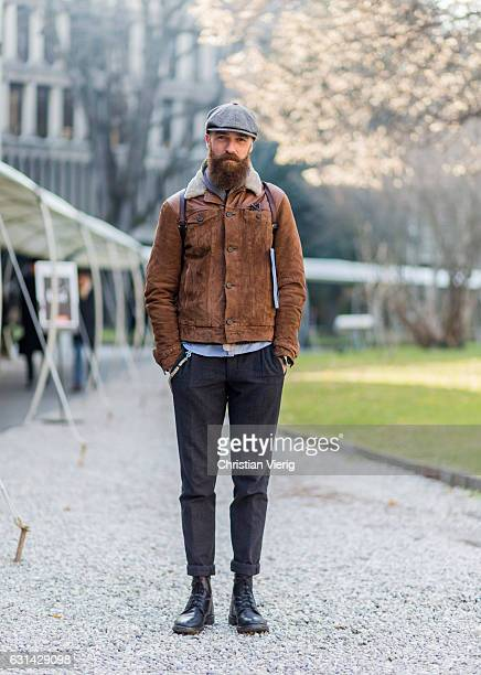 Alessandro Meneghetti is wearing a flat cap brown leather jacket grey pants black boots on January 10 2017 in Florence Italy