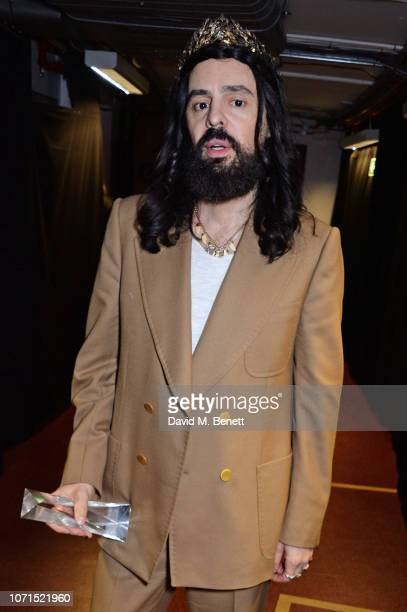 Alessandro Michele accepting the Brand of the Year award on behalf of Gucci poses backstage at The Fashion Awards 2018 in partnership with Swarovski...