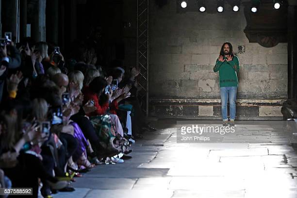 Alessandro Michele Gucci Creative Director bows on the runway during the Gucci Cruise 2017 fashion show at the Cloisters of Westminster Abbey on June...