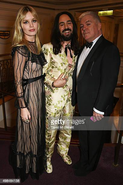 Alessandro Michele winner of the International Designer Award poses with Georgia May Jagger and Tim Blanks at the British Fashion Awards in...