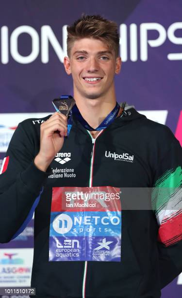 Alessandro Miressi of Italy celebrates with his gold medal following the men's 100m freestyle final during the Swimming on Day Four of the European...