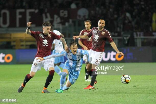 Alessandro Murgia and Daniele Baselli competes for the ball during the Serie A football match between Torino FC and SS Lazio at Olympic Grande Torino...