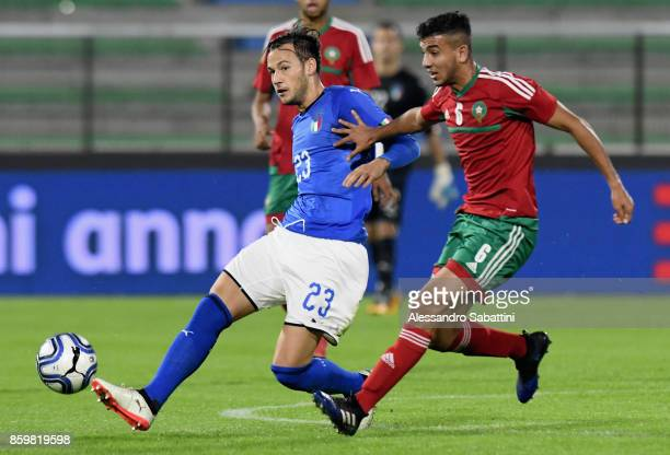 Alessandro Murgia of Italy U21 competes for the ball whit Anas Bach of Marocco U21 during the international friendly match between Italy U21 and...